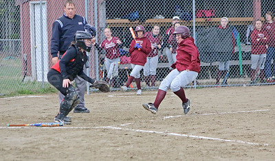 Eagles senior Emma Weed begins to slide home as GSA puts a run on the scoreboard against Central. Photo by Anne Berleant