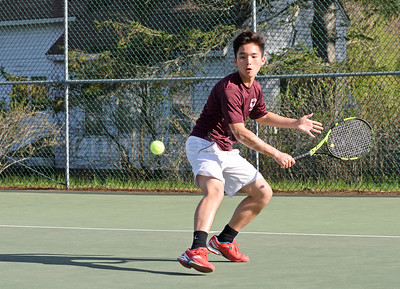 Bryant Hsiung attacks in the third singles match against Lee Academy Photo by Franklin Brown