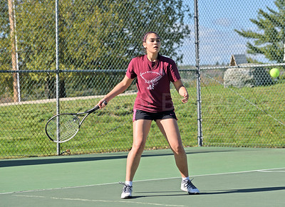 Julianna Allen swings against Lee Academy in a first singles match. Photo by Franklin Brown