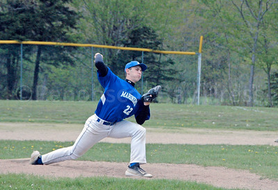 Mason Oliver aims for the strike zone as the Mariners cruise to a win against Schenck on May 22. Photo by Jack Scott
