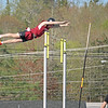 """Alex Taylor-Lash soars 10'06"""" to take first place in the pole vault at the Hancock County meet in Ellsworth on May 19. Photo by John Richardson"""