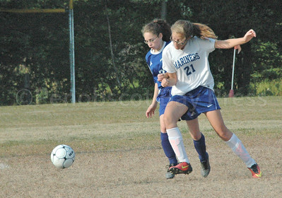 Sports_DIS_girls_soccer_v_searsport_riiley_fights_for_position__091417_JS