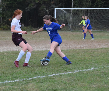Sports_dis_girls_soccer_Maycee_turns_the_ball_092619_JS