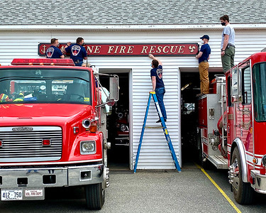 CP_fire_dept_sign_hanging_new_sign_041521_RW