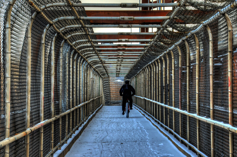 Riding the Cedar Avenue walking  Bridge