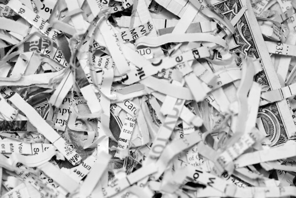 [365.123] Hidden Portrait <i>Alameda, California — May 3, 2009</i>  I thought it would be interesting to take a photograph of all our shredded paper.  But it always strikes me as such a waste, as so much of it is junk mail -- credit card offers we don't want, personal information, and the like.  This is my effort at a conceptual photograph showing this reaction.  © Brendan Cox — All Rights Reserved