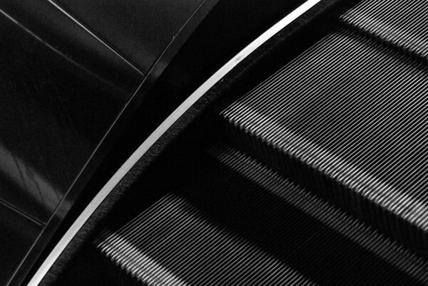 [365.012] (Moving) Stairway to Broadway Street <i>Oakland, California — January 12, 2009</i>  Every day, Elizabeth rides the escalator up from the 12th St station to meet me on our way home from work. Sometimes I'm lazy and stay in the car (or I'm late, and she has to wait for me), but when I'm being a good husband, I walk over to meet her. I love being there to greet her as she gets out of BART.   On a side note (or was that the side note?), I love how overwhelmingly geometrical this photograph is.  © Brendan Cox — All Rights Reserved