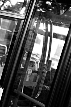 [365.272] The doors on the bus... <i>Alameda, California — September 29, 2009</i>  There almost always seems to be an AC Transit bus parked on the street a couple blocks from our house. We think the drivers give the nearby KFC half of its business.   © Brendan Cox — All Rights Reserved