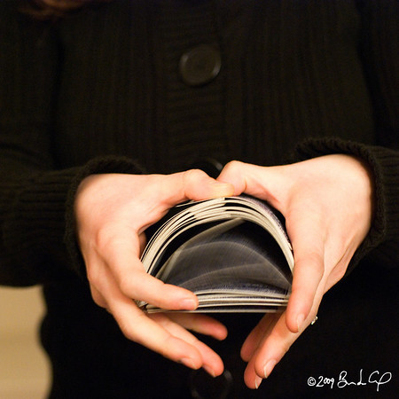 """[365.009] Bridge  <i>Alameda, California — January 9, 2009</i>  <a href=""""http://www.flickr.com/photos/mcmlxxxvi/3172494885/"""">Elizabeth</a> shuffling cards for our cheap date night -- cooking dinner together (tofu with mushrooms, bok choy, and kabocha) and getting beaten down at <a href=""""http://en.wikipedia.org/wiki/Cribbage"""">cribbage</a>. Twice.   If you look carefully, it seems like she's making a ♥ at me. But it's probably just to ask me to love her even after she decimates me.  © Brendan Cox — All Rights Reserved"""