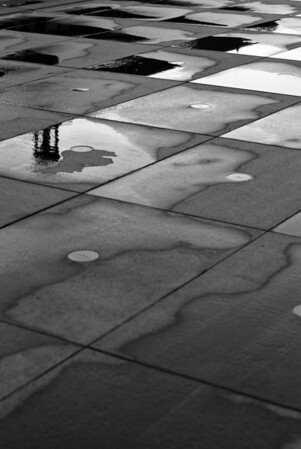 [365.155] Reflections <i>Bordeaux, France — June 4, 2009</i>  Reflections of an old building in a public fountain in Bordeaux.  © Brendan Cox — All Rights Reserved
