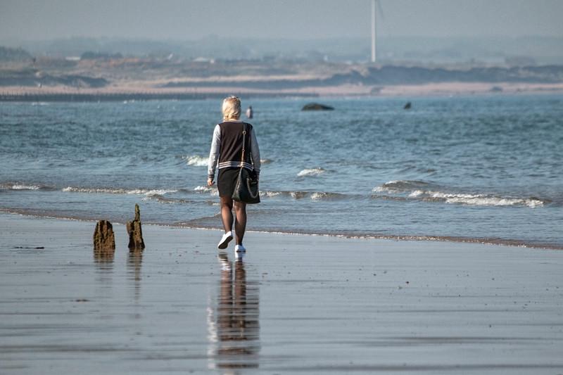 Girl walking on the beach.jpg