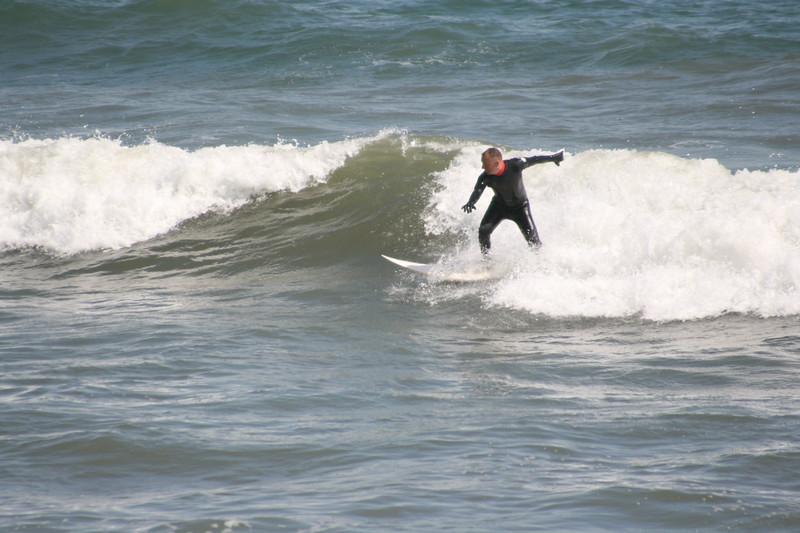 Surffing on waves.JPG