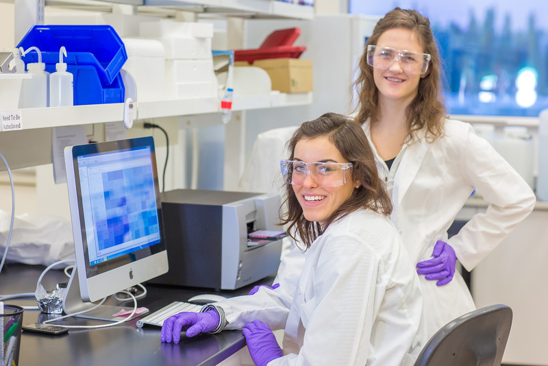 """Undergraduate Alyssa Komac, right, and graduate student Theresia Schnurr study the data they're getting in their research involving the metabolism in Alaska sled dogs.  <div class=""""ss-paypal-button"""">Filename: AAR-12-3673-99.jpg</div><div class=""""ss-paypal-button-end"""" style=""""""""></div>"""
