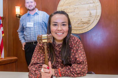 Kelsey Wallace, a senior in UAF's rural development program from Bethel, has some fun with the gavel moments after posing with Speaker Mike Chenault in the House chambers during a weeklong seminar on understanding the legislative process in Juneau.  Filename: AAR-14-4053-149.jpg
