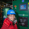 "Graduate student Lisa Stowell inspects newly installed equipment in the UAF power plant designed to help capture heat generated by diesel engines.  <div class=""ss-paypal-button"">Filename: AAR-11-3245-191.jpg</div><div class=""ss-paypal-button-end"" style=""""></div>"