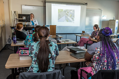Students in CTC's medical assisting program gather in a classroom to watch a training video at the program's facility on Barnette Street in downtown Fairbanks.  Filename: AAR-16-4873-343.jpg