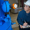 "Stefan Weingarth checks the reading on the oil well head at CTC's process technology facility on Van Horn Road.  <div class=""ss-paypal-button"">Filename: AAR-11-3230-014.jpg</div><div class=""ss-paypal-button-end"" style=""""></div>"