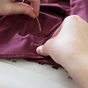 """Student employee and theatre major Stephanie Sandberg enjoys sewing as part of her job in the costume shop at Theatre UAF.  <div class=""""ss-paypal-button"""">Filename: AAR-14-4104-20.jpg</div><div class=""""ss-paypal-button-end"""" style=""""""""></div>"""
