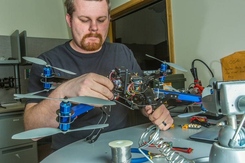 "Technician Michael Cook works on one of the unmanned aerial vehicles in UAF's Alaska Center for Unmanned Aircraft Systems Integration (ACUASI) shop in south Fairbanks.  <div class=""ss-paypal-button"">Filename: AAR-13-4026-80.jpg</div><div class=""ss-paypal-button-end""></div>"