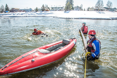 Staff members and graduate students from the Water and Environmental Research Center (WERC) and the Institute of Northern Engineering (INE) receive swiftwater rescue and safety training in the Chena River.  Filename: AAR-13-3813-120.jpg