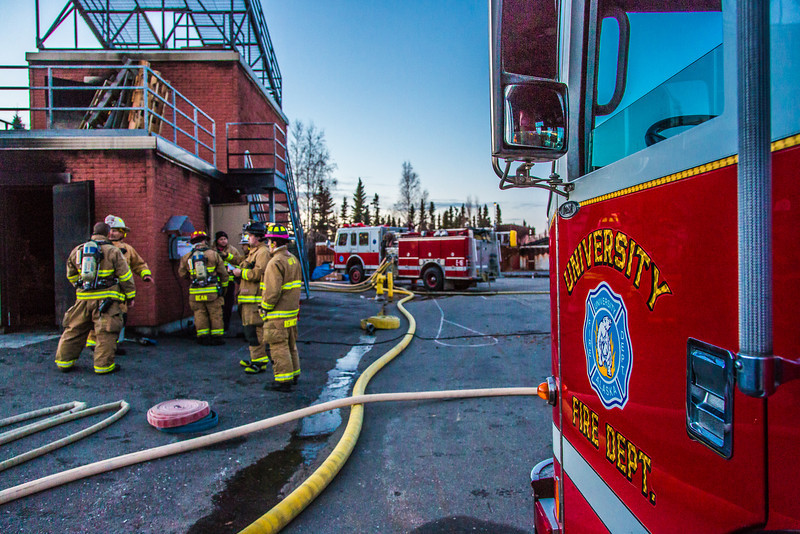 "Students with the University Fire Department prepare for a regular live training drill at the Fairbanks Fire Training Center.  <div class=""ss-paypal-button"">Filename: AAR-13-3978-16.jpg</div><div class=""ss-paypal-button-end"" style=""""></div>"