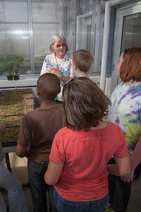 Professor Pat Holloway with UAF's Agricultural and Forestry Experiment Station leads a group of Fairbanks school children through a tour of the new SNRAS greenhouse on Research Day 2012.  Filename: AAR-12-3364-03.jpg