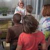 "Professor Pat Holloway with UAF's Agricultural and Forestry Experiment Station leads a group of Fairbanks school children through a tour of the new SNRAS greenhouse on Research Day 2012.  <div class=""ss-paypal-button"">Filename: AAR-12-3364-03.jpg</div><div class=""ss-paypal-button-end"" style=""""></div>"