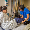 "Chloe Gilbreath, right, and Laura Castro alternate practicing proper techniques for helping patients out of bed during an exercise in CTC's Nursing Assistant training at the program's facility on Barnette Street in downtown Fairbanks.  <div class=""ss-paypal-button"">Filename: AAR-16-4873-223.jpg</div><div class=""ss-paypal-button-end""></div>"