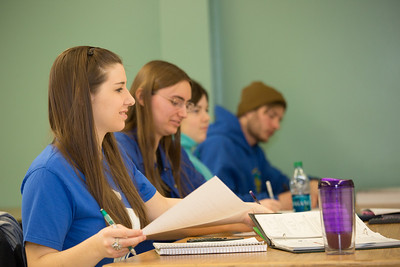 Schoof of Management students Sophie Marcinkowski, Emily Blanchard, Emily Ahem and Brennan LaBuda take notes in their intermediate accounting class.  Filename: AAR-14-4112-64.jpg