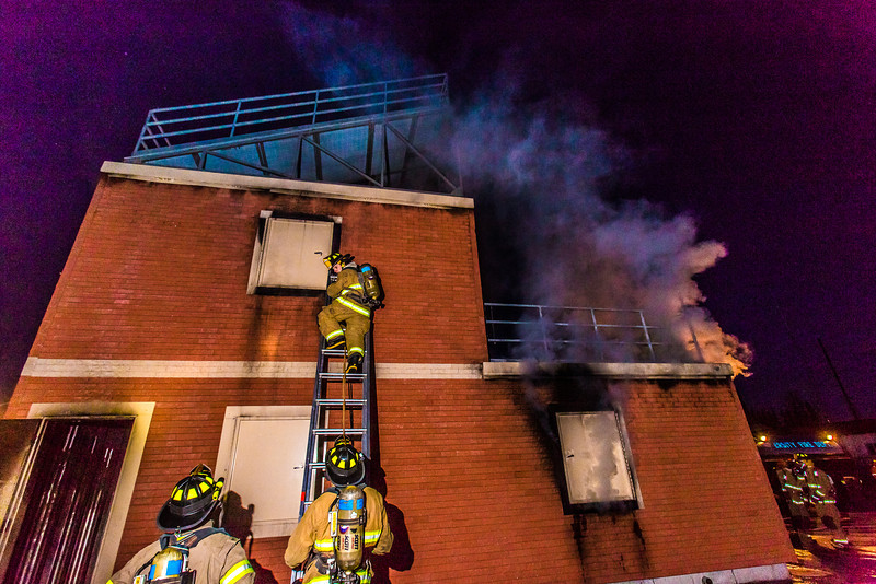 """Student fire fighters with the UFD prepare to enter the second floor of a burning building during a live training drill at the Fairbanks Fire Training Center.  <div class=""""ss-paypal-button"""">Filename: AAR-13-3978-88.jpg</div><div class=""""ss-paypal-button-end"""" style=""""""""></div>"""