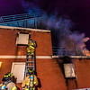 "Student fire fighters with the UFD prepare to enter the second floor of a burning building during a live training drill at the Fairbanks Fire Training Center.  <div class=""ss-paypal-button"">Filename: AAR-13-3978-88.jpg</div><div class=""ss-paypal-button-end"" style=""""></div>"