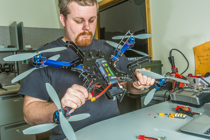 "Technician Michael Cook works on one of the unmanned aerial vehicles in UAF's Alaska Center for Unmanned Aircraft Systems Integration (ACUASI) shop in south Fairbanks.  <div class=""ss-paypal-button"">Filename: AAR-13-4026-82.jpg</div><div class=""ss-paypal-button-end""></div>"