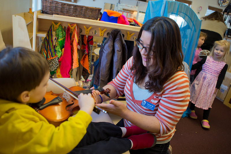 """Sooyun Chi works with pre-schoolers at the Bunnell House on the UAF campus as part of her internship for a degree in early childhood development.  <div class=""""ss-paypal-button"""">Filename: AAR-12-3335-024.jpg</div><div class=""""ss-paypal-button-end"""" style=""""""""></div>"""
