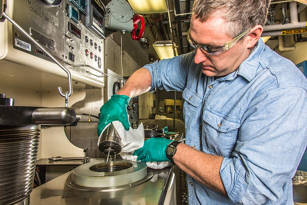"""Research professional Matt Bray studies pressurized petroleum samples in a Duckering Building rock mechanics lab.  <div class=""""ss-paypal-button"""">Filename: AAR-13-3919-48.jpg</div><div class=""""ss-paypal-button-end"""" style=""""""""></div>"""