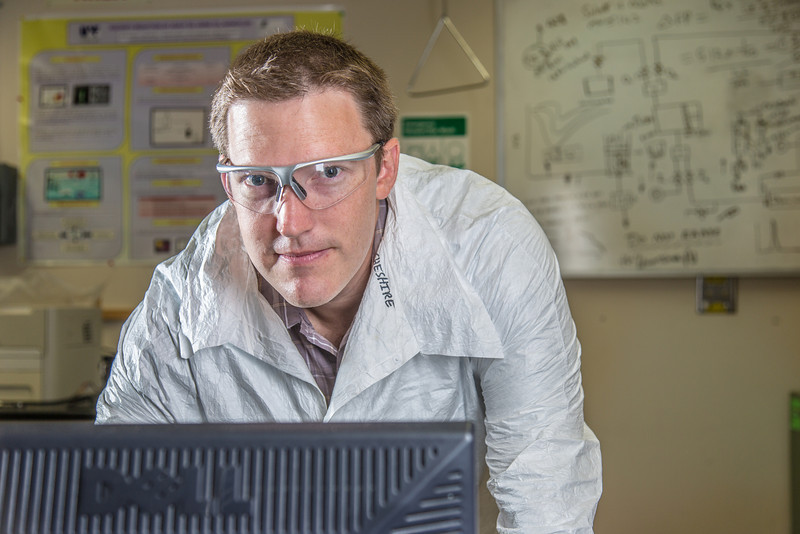 """Undergraduate John Cheshire conducts research in UAF's Petroleum Development Lab in the Duckering Building.  <div class=""""ss-paypal-button"""">Filename: AAR-13-3918-10.jpg</div><div class=""""ss-paypal-button-end"""" style=""""""""></div>"""