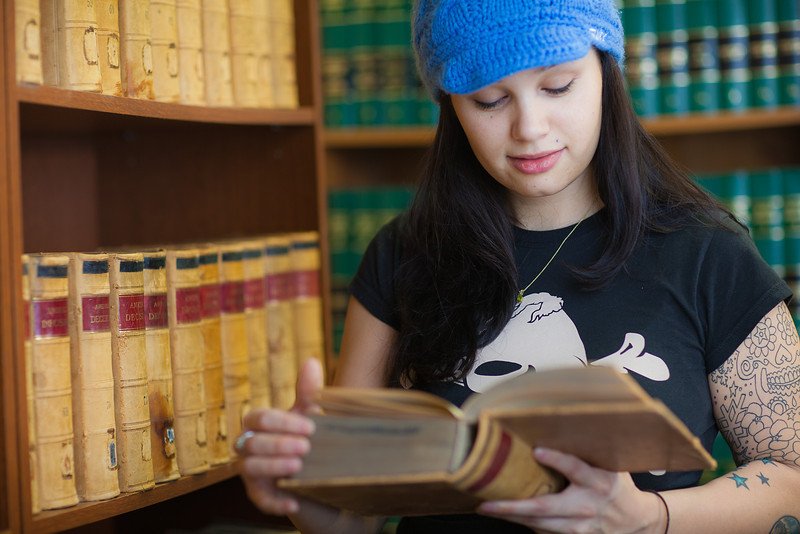 """Samantha D'Hondt conducts some research for her paralegal studies class at CTC's law library.  <div class=""""ss-paypal-button"""">Filename: AAR-11-3225-39.jpg</div><div class=""""ss-paypal-button-end"""" style=""""""""></div>"""