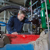 """Research professional Dave Light inspects tubing installed at the UAF Power Plant designed to help capture waste heat.  <div class=""""ss-paypal-button"""">Filename: AAR-11-3245-284.jpg</div><div class=""""ss-paypal-button-end"""" style=""""""""></div>"""