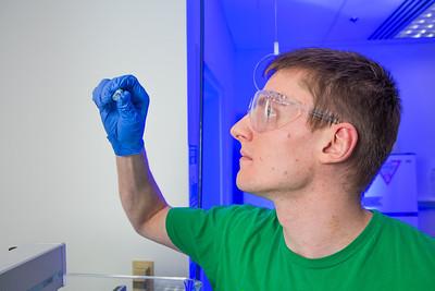 Chemistry major James Micah Simmerman completes a procedure in a Reichardt Building lab.  Filename: AAR-12-3598-134.jpg