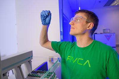 Chemistry major James Micah Simmerman completes a procedure in a Reichardt Building lab.  Filename: AAR-12-3598-131.jpg