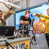 "Chris Wilson works out on a stair step machine while classmates Ashley Jacobs (in yellow) and Marisol Bastiani collect data measuring his respiration during a human physiology lab in the Murie Building.  <div class=""ss-paypal-button"">Filename: AAR-13-3983-14.jpg</div><div class=""ss-paypal-button-end"" style=""""></div>"