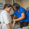 "Chloe Gilbreath, right, and Laura Castro alternate practicing proper techniques for helping patients out of bed during an exercise in CTC's nursing assistant training at the program's facility on Barnette Street in downtown Fairbanks.  <div class=""ss-paypal-button"">Filename: AAR-16-4873-243.jpg</div><div class=""ss-paypal-button-end""></div>"
