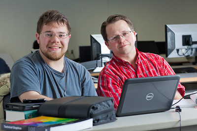 Assistant professor Thane Magelky, right, works with freshman James Griffin in his drafting technology class in the CTC center downtown.  Filename: AAR-11-3221-45.jpg