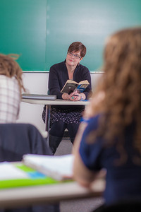 Professor Alexandra Fitts listens to students in her Hispanic Theater class during a recent meeting in the Gruening Building.  Filename: AAR-12-3350-08.jpg