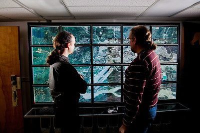 Computer science faculty members Orion Lawlor, left, and Jon Genetti inspect a high resolution aerial photo of Fairbanks on the bioinformatics powerwall in the Chapman Building.  Filename: AAR-12-3272-125.jpg