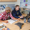 "Paskal, left, and Ed King work on a project in the office of the Alaska Center for Energy and Power on the Fairbanks campus.  <div class=""ss-paypal-button"">Filename: AAR-11-3245-68.jpg</div><div class=""ss-paypal-button-end"" style=""""></div>"