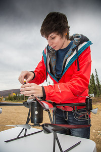 Students take part in a project using unmaned aerial vehicles (UAVs) at Poker Flat Research Range about 40 miles northeast of the Fairbanks campus. (Note: Taken as part of commercial shoot with Nerland Agency. Pretend class -- use with discretion!)  Filename: AAR-12-3560-029.jpg