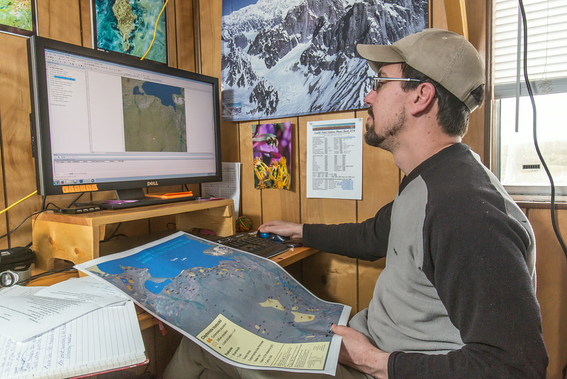 """Research technician Randy Fulweber supports research efforts at IAB's Toolik Field Station in the GPS unit.  <div class=""""ss-paypal-button"""">Filename: AAR-14-4216-040.jpg</div><div class=""""ss-paypal-button-end""""></div>"""