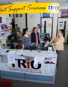 Staff members Vernae Angnaboogok, left, Sarah Smith and Jen Bergstrom greet students at the front counter of UAF's Student Support Services.  Filename: AAR-12-3285-177.jpg