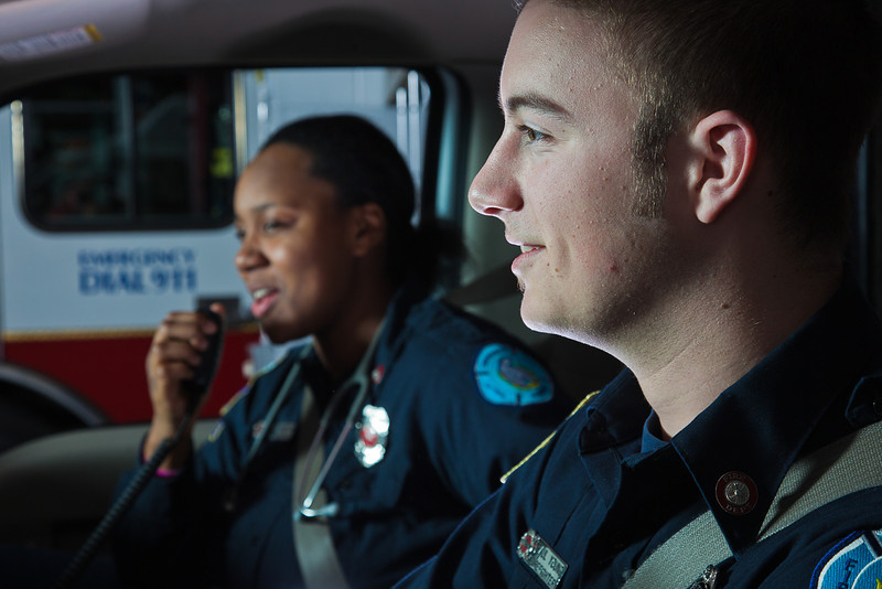 """UAF student firefighters/EMTs Lillian Hampton and Paul Young prepare to respond to an emergency call from the front of an ambulance housed in the Whitaker Building on the Fairbanks campus.  <div class=""""ss-paypal-button"""">Filename: AAR-11-3223-86.jpg</div><div class=""""ss-paypal-button-end"""" style=""""""""></div>"""