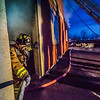"Student firefighter Ethan Stevenson exits a burning building during a live training drill at the Fairbanks Fire Training Center in South Fairbanks. McClean was one of about 30 students participating in the University Fire Department's Tuesday night drill Oct. 22.  <div class=""ss-paypal-button"">Filename: AAR-13-3978-135.jpg</div><div class=""ss-paypal-button-end"" style=""""></div>"